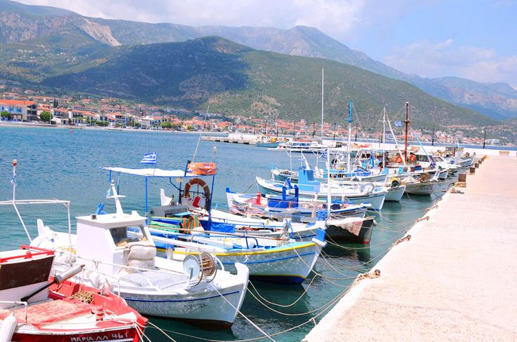 Small boats in the Port of Tyros in Peloponnese. One of the most beautiful places to stay in Greece especially if you are looking for relaxed summer holidays.