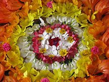 Formal circular color design.  While this example is from an Onam festival house decoration in Kerala, India, such designs were also popular for Victorian hand bouquets.
