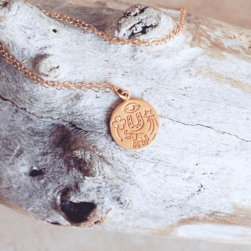 "LUCKY YOU PENDANT  79.00 Need some good luck? The Lucky You Pendant has got you more than covered. Five symbols, one sweet 24K gold vermeil pendant, lot's of blessings.   24 K. gold dipped vermeil luck pendant 14mm 20"" Gold fill chain"