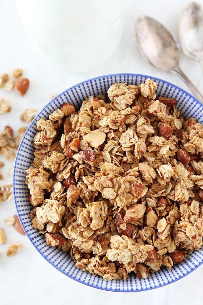 Almond Butter Granola Recipe on http://twopeasandtheirpod.com This is the BEST homemade granola recipe. It is great with yogurt, milk, or eaten by the handful!
