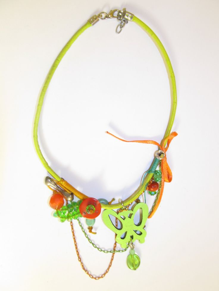 Handmade short leather necklace (1 pc)  Made with light green leather butterfly,  light green leather cord, colourful chains, wax cords, ribbon, swarovski strass, corals ans glass beads.
