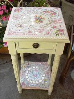 Broken china mosaic, another great table, some moldings and a drawer pull. The mosaic would be hard to duplicate I'm sure.