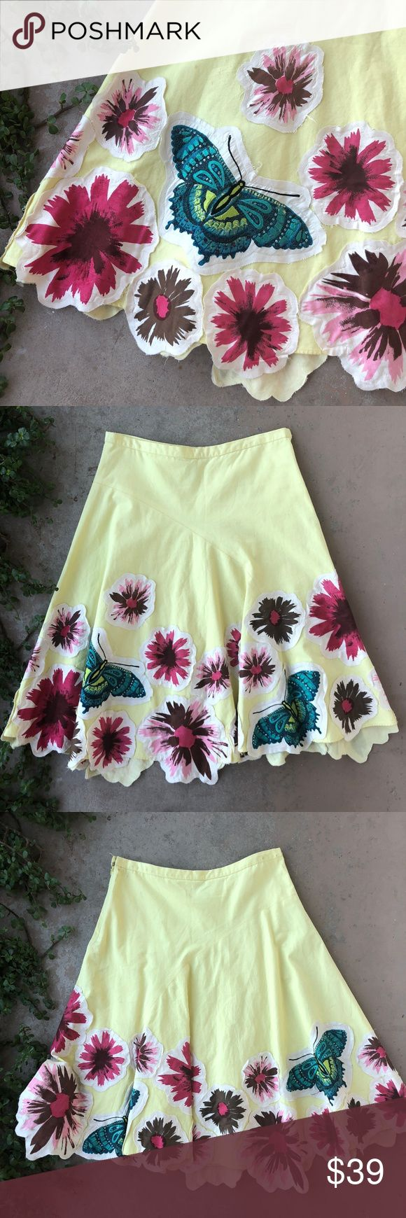 """Anthropologie Odille Yellow A-Line Butterfly Skirt Yellow A-Line tea length skirt by Odille from Anthropologie. Features darling butterfly and floral patches along the bottom for an asymmetrical hemline. 100% cotton. Size 6 and measures about 15"""" across the waist and 25"""" long. In excellent condition, no flaws! Anthropologie Skirts Midi"""