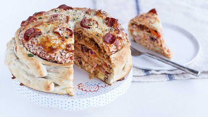 Pillsbury dough wraps around 5 different flavors of pizzas in a one-of-a-kind pizza party cake!