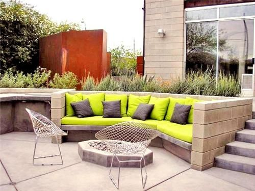 Great idea for a sunken patio! Colorful and cozy seating surround an octagonal fire pit. Design by Realm, an Urban Organics Company in Tucson, AZ.