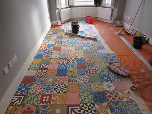 Thoughts on these Marrocan Cement Tiles.   Photos - Protilers - Marrocan Cement Tiling In W10. | Page 2 http://www.tilingforum.co.uk/threads/protilers-marrocan-cement-tiling-in-w10.2042/page-2#post-37610