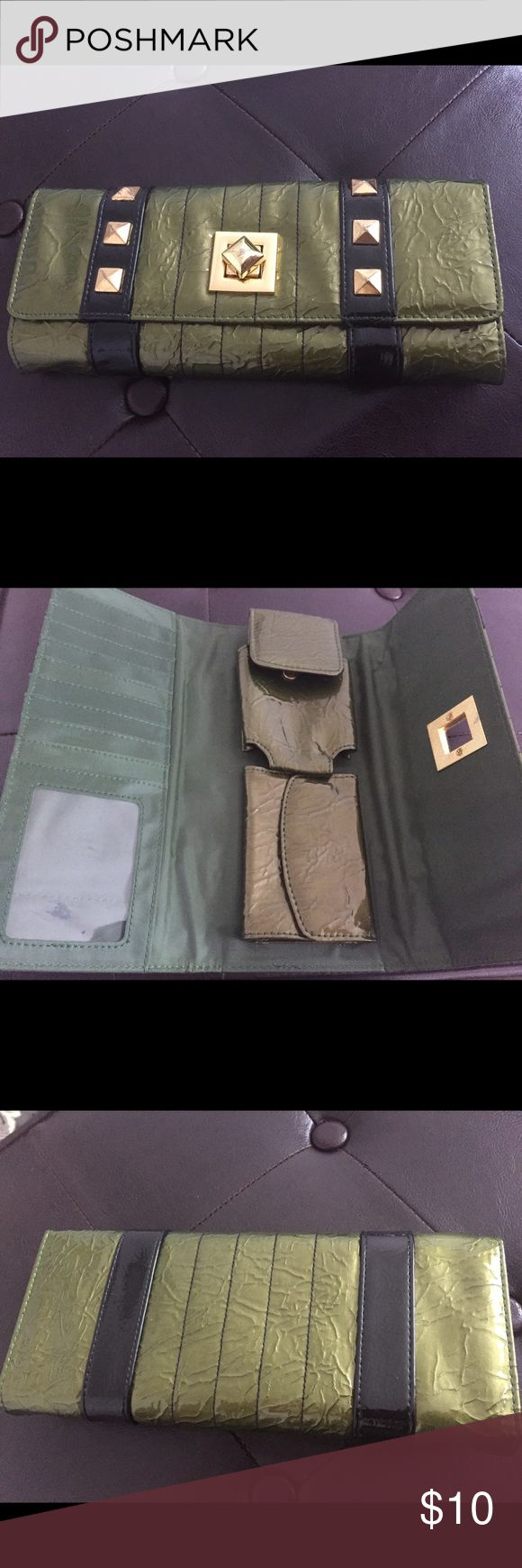 Clutch from the buckle store Hi! I'm unsure of the brand of this clutch but I know it was a gift to me from the buckle store. Lots of slots for cards and Id. Also can store a small phone & some coins, both storage have snap closures. Some imperfection to the hardware as shown in photo, not too noticeable and honestly goes with the worn in look of the wallet. There's also small mark that can be seen on the id portion not the bottom right that's a shadow but toward the middle bottom :p Bags…