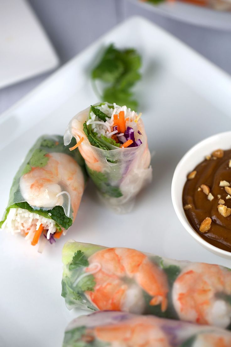 Fresh Shrimp Rolls with Hoisin Peanut Sauce - Shrimp spring rolls with peanut dipping sauce are a favorite Vietnamese appetizer, and they're also super-fun to make at home. Simply fill some rice noodle wrappers with cooked shrimp, noodles, and your favorite veggies—then wrap and enjoy! http://www.jessicagavin.com/test-kitchen/appetizers/fresh-shrimp-spring-rolls-with-peanut-dipping-sauce/