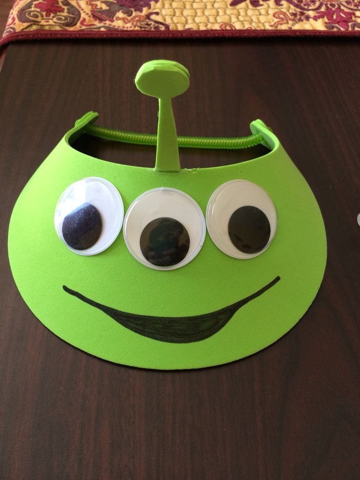 DIY Toy Story alien hat. Super fast and easy. Hot-glue big googly eyes into a green foam visor. Cut an antenna out of green craft foam (I did a double layer) and hot-glue on. Draw a mouth with sharpie. Done!