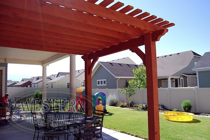 Free standing ShadeScape™ solid wood pergola kit installed with custom stain and Roosevelt beam and rafter profiles.