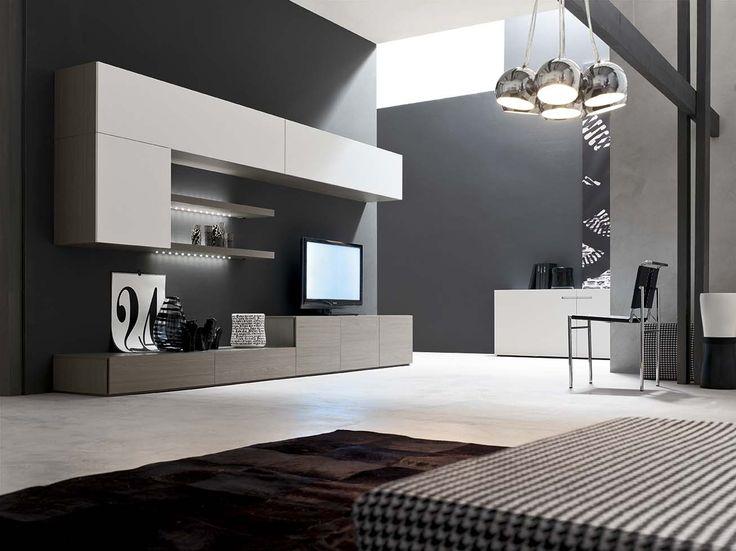 Living mobilificio Santa Lucia con basi rovere cenere e pensili eco bianco: il design con volumi differenti.