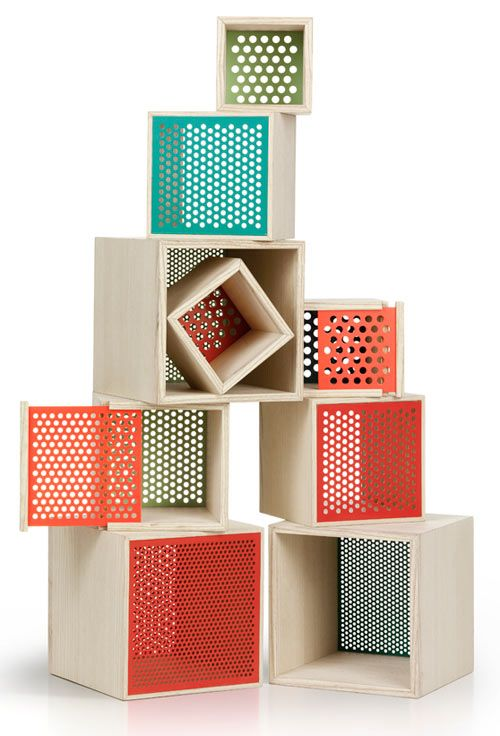 Keep cubes from Note Design Studio.  Simple wooden cube boxes that let you decide how much you want to show or to keep inside.