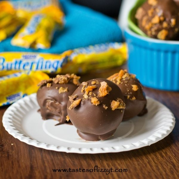 You'll love this tornado of cream cheese, Nutter Butter cookies and Butterfinger candy bars rolled up and covered in chocolate. Here it is: another tornado truffle.  Butterfingers are one of my favorite candies (besides all of the other candy at the cash register!).  I used to love eating them- that is, until I got braces.  I was really sad that I couldn't eat all of my favorite candies, like Skittles, Butterfingers, and bubble gum.  When we made these truffles, obviously [Continue Reading]