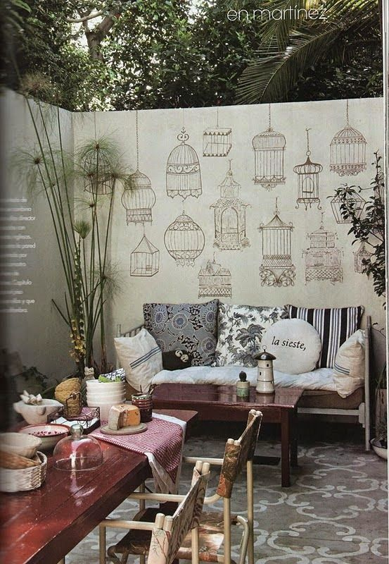 A large plain wall can be simply adorned with stencils or real bird cages.