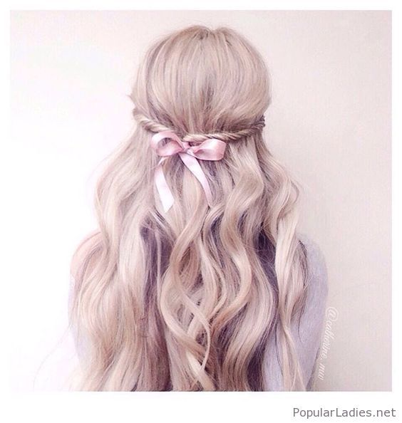 Long blonde curls with a nice pink bow