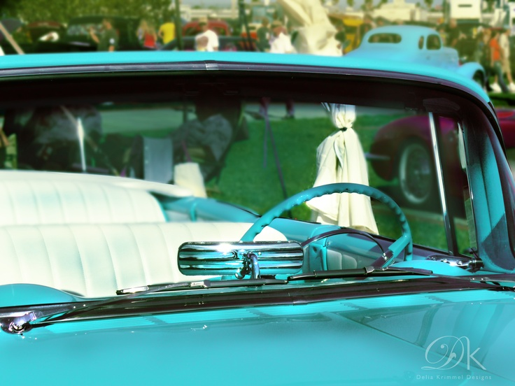It's pretty proper to put mini curtains on your car...privacy please! I imagine pin up shots with brunettes wearing a red polka dot bandana! — at Daytona International Speedway.
