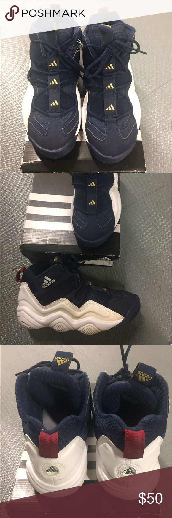 "Adidas Basketball sneaker Navy, white and burgundy adidas basketball shoe. Closely resembles ""crazy 8s"". Slight yellowing on outside of right shoe. Haven't tried to clean it yet. If I can get it off I will take pics of the clean shoe. MAKE AN OFFER !! adidas Shoes Sneakers"