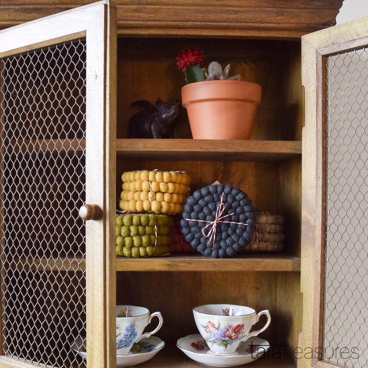 Shelfie with felt ball coasters and old porcelain teacups. #shelfie