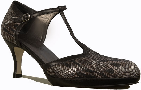 Turn heads in 'Mozas' by Amante. This glamorous, take-me-out pump features Amante's Vestock leather-like sole, full leather lining, a well-cushioned leather footbed with a 1/2 inch platform for comfort, and snake printed leather uppers with an upscale T-strap and adjustable ankle strap. Made in Spain.