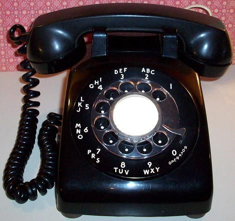 Good ol' rotary dial phone.. Remember thinking this phone was so ugly my grandma I'm had the same one