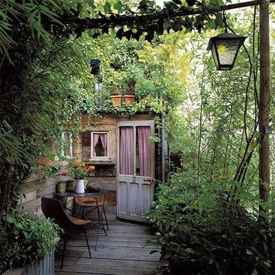 Le Petit Jardin, une Cabane et une Terrasse. Parfait! (A little garden, a sweet cabin and a terrace) So inviting and cozy. Love it!!! @Sarah Chintomby Nasafi this would be awesome for your cabin, between the house!                                                                                                                                                     Plus