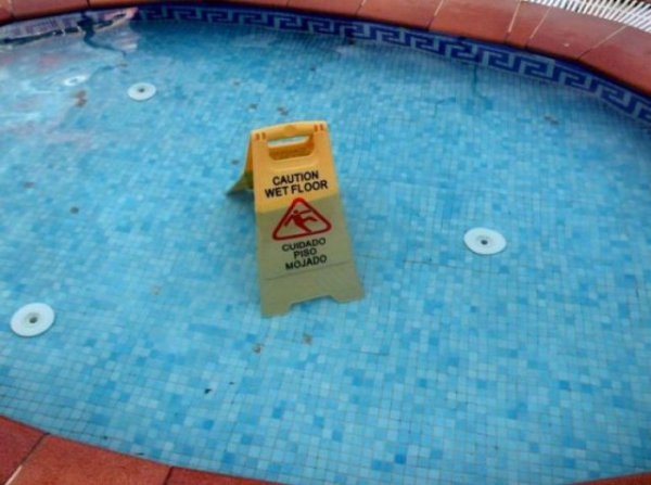 Wet Floor Sign In Pool. Caution: Empty Pool Not Empty. caution, swimming pool, wet floors, Signs