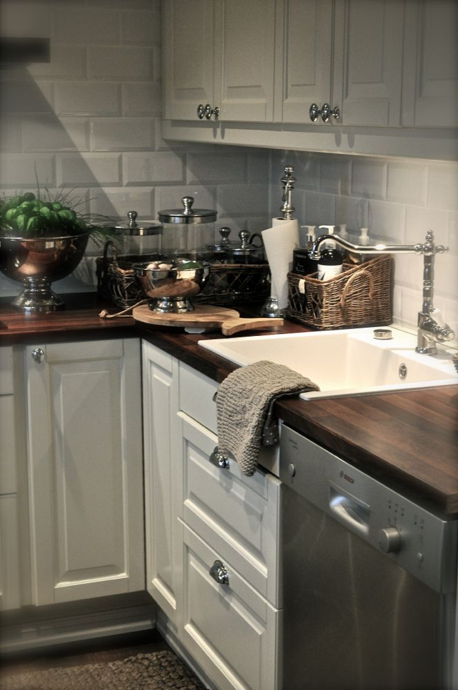 Kitchen-love the white matte subway tile with the dark butcher block. Like I said -you take cheap butcher block and stain it dark for a rich and elegant look.-lsm