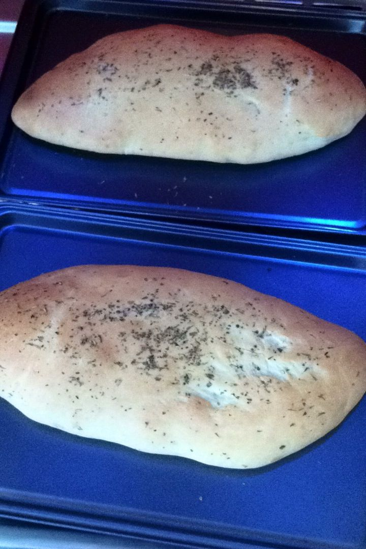 This was my first attempt at Focaccia. Not quite herby or fluffy enough but a gorgeous gorgeous bread! maybe it was my kneading technique... don't know why it turned out so dense!  Also might add olives next time