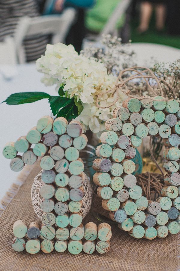 painted wine cork table numbers, photo by Next to Me Studios http://ruffledblog.com/seafoam-california-wedding #diy #diyproject #tablenumbers