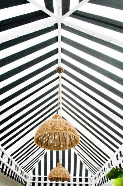 rattan chandelier/striped celing