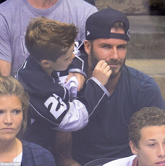 Can't wait to have one! Cruz Beckham playfully tugged on his father David Beckham's mustache at the Kings vs. Blackhawks game in Los Angeles on Friday