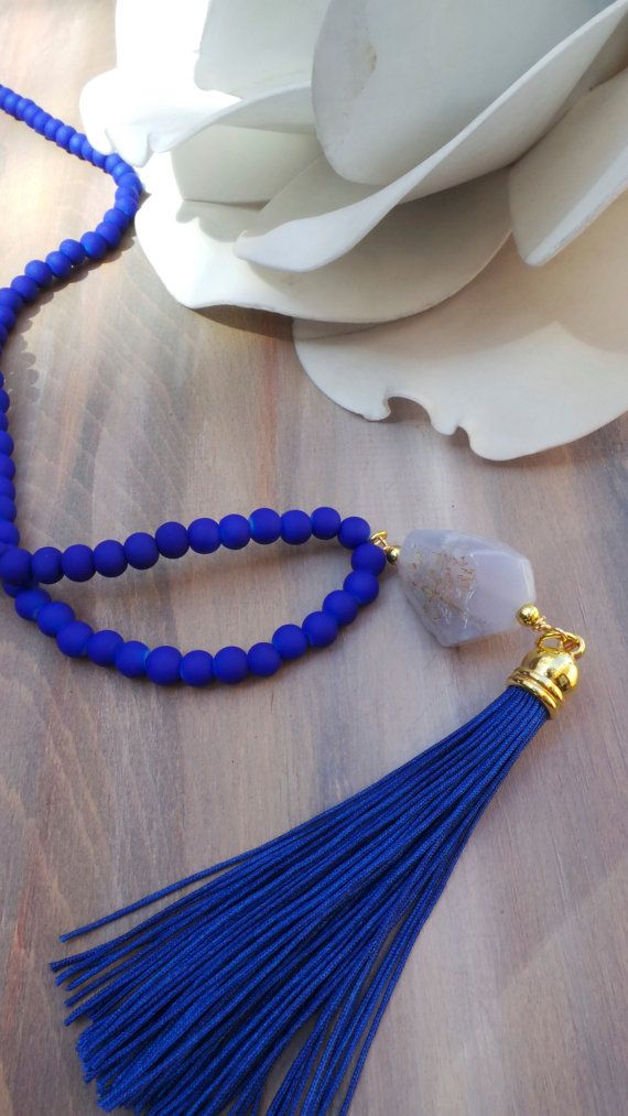 This tassel necklace is lovely and is one of my most favourited listings. I have made it using 6mm matt glass beads, a handmade tassel and a beautiful blue lace agate nugget. Please note that each stone is unique as this is a raw material . They are not perfect but this I think is what makes them so special. You can see some in the last photo.   Length: The options I give is the length of the beads from end to end. If you choose the shorter option you will have a final drop of around 21 and…