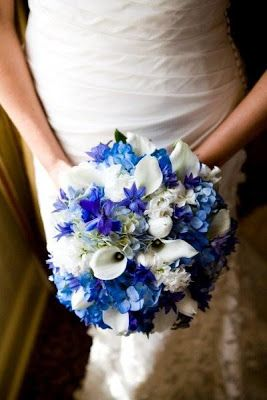 You can have blue flowers in your bouquet. You can choose to include cornflowers, delphiniums, blue posies, anemones, hyacinths or hydrangeas into your bouquet. Other floral colors that seem to be look good with blue: white, yellow and pink. To match, think about using blue flowers or ribbon on the boutonniere!