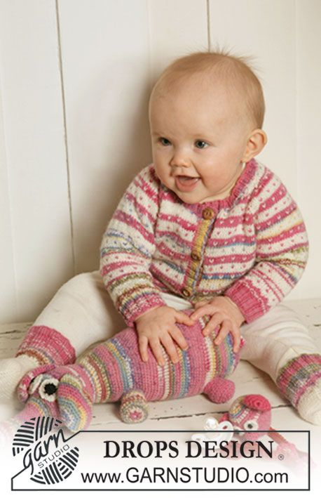 """Set comprises: Knitted DROPS jacket with stripes, dots and raglan and socks in """"Fabel"""". Crochet DROPS fabulous animal in """"Fabel"""". Crochet DROPS dummy holder in """"Fabel"""" and """"Merino Extra Fine""""."""