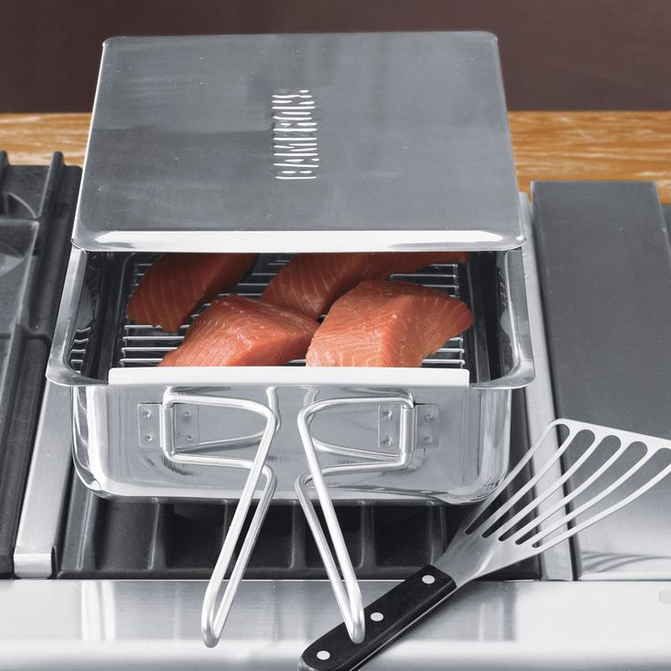 "Use this Stovetop Smoke on an indoor stove-top, or outside on a back yard grill or campfire and get the savory flavor and low-fat benefits of wood-smoking. Features long loop handles that stay cool during normal stovetop use and fold in for easy storage. Each smoker arrives with an easy-to-clean nonstick rack, cookbook, and instructions. - The large smoker measures 15""l x 11""w x 3 1/2""h and comes with two sample packs of smoking chips (Alder and Hickory). - The small smoker measures 11""l x…"
