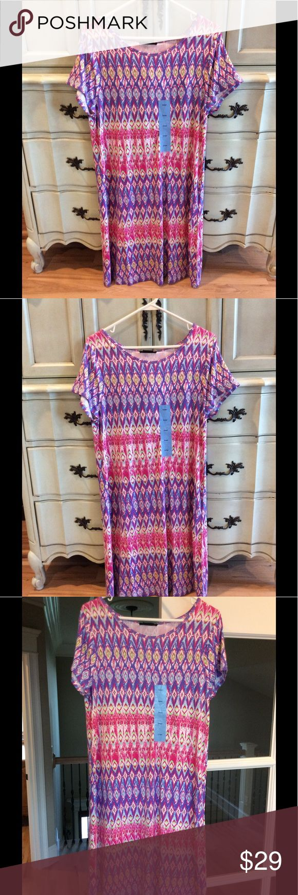 Pink aztec dress shift womens large stretch beach So amazingly comfy! I wore mine to Church with flip flops. 95% viscose and 5% spandex. Hits at my knee. u knit Dresses Midi