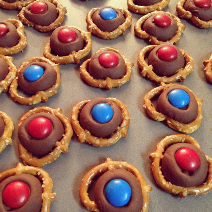 Melt Kisses in oven and top with M&M's in the team colors - an easy favorite.   #volleyball #snacks #entertaining #charm  charmetiquette.com simplyput.com