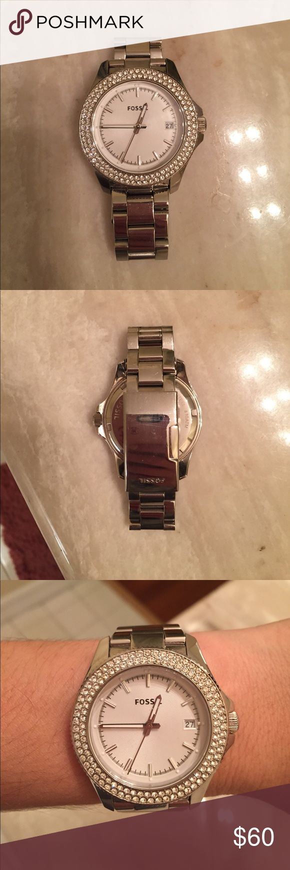Fossil Stainless Steel Watch Fossil women's watch. Used with small scratches on link but nothing on face of watch. Needs battery replacement and cleaning. Includes extra links and price tag from Macy's. Ask me any questions :) Fossil Accessories Watches