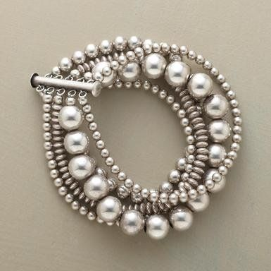 and, a silver beaded bracelet...