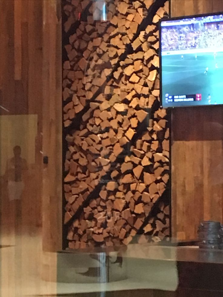 This feature timber wall design is ideally suited in this interior space. This is a smoke house and so the textured patterned element is perfect for the rustic charm of its environment.