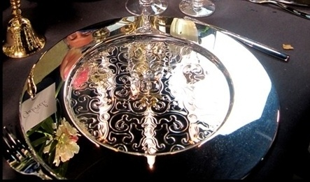 The 18/10 stainless steel tray of the Dressed Collection by Marcel Wanders and Alessi