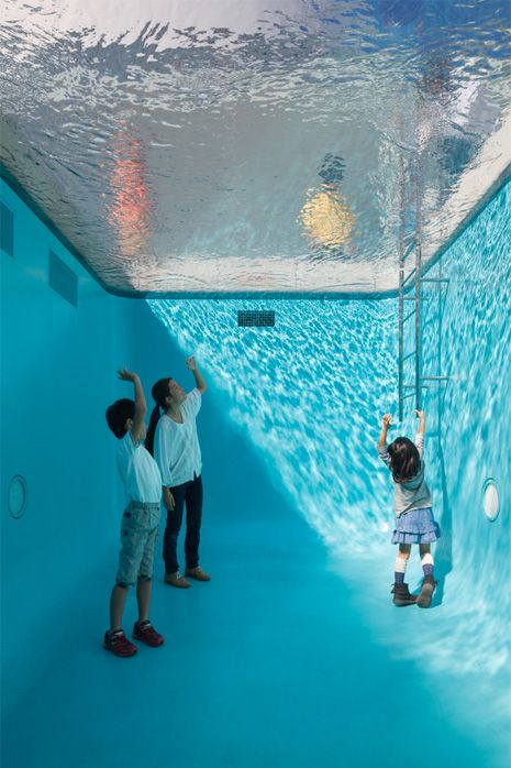 Simulated swimming pool with room inside...When viewed from the deck, the pool appears to be filled with deep, shimmering water. In fact, however, a layer of water only some 10cm deep is suspended over transparent glass. Below the glass is an empty space with aquamarine walls that viewers can enter.