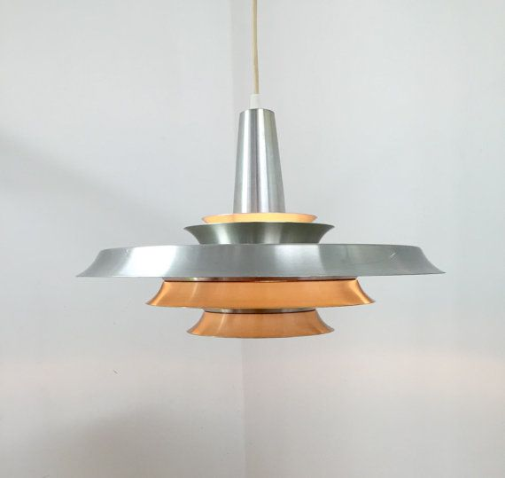 A large Carl Thore lamp designed in the 1960s in Sweden. The brushed steel and the white inner shades gives a cool look to this cobtemporary lamp. The
