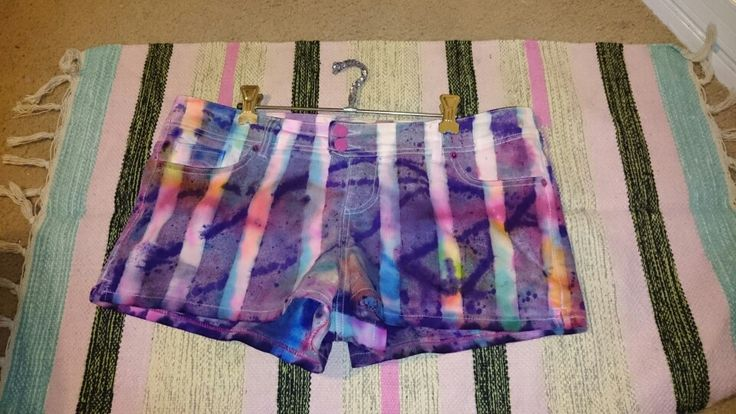Shorts diy. Start with sharpies and metho in rainbow colours. Then apply masking tape stripes and spray with dye