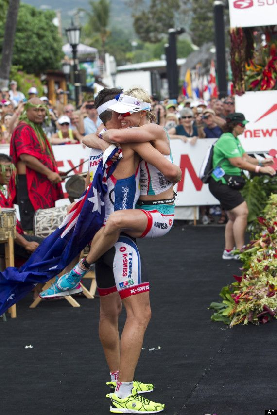 """Mirinda """"Rinny"""" Carfrae jumping into her fiancé's arms seconds after winning the 2013 Ironman World Championship in Kona. She ran the marathon 8 minutes faster than ANY of the top 10 women and beat 8 of the top 10 male pro marathon times! Ridiculous talent..."""