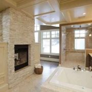 Crema Marfil Ledger on Fireplace,with Carrera Marble Flooring