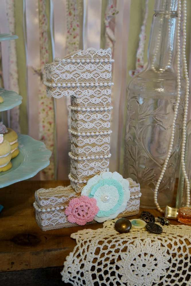 Lace number at a vintage shabby chic, pink, turquoise, mint green birthday party! See more party planning ideas at CatchMyParty.com!