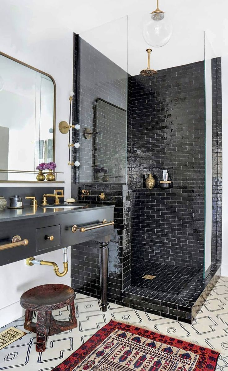 This sophisticated, boho restroom interior plays with tile combinations here. Come see our amazing structures at Risingbarn.com.