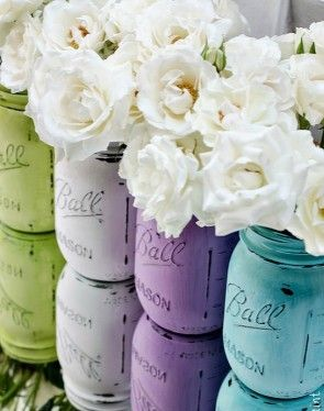 Distress jars using acrylic paint and a nail file (or sandpaper) and use as vases