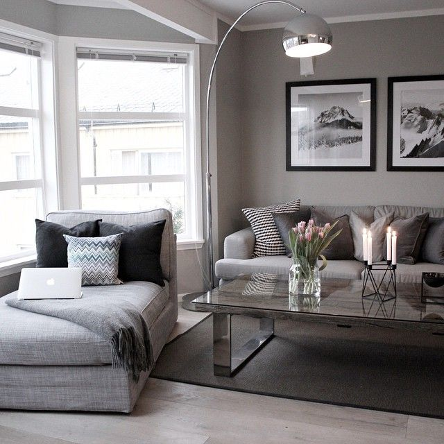 Light grey living room with dark Frames
